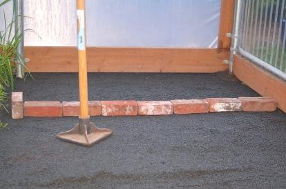 hoophouse- compacting floor base