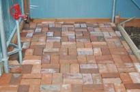 winter project- hoophouse floor in potting area